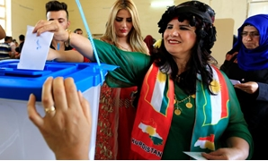 A woman casts her vote at a polling station during Kurds independence referendum in Kirkuk, Iraq September 25, 2017- REUTERS