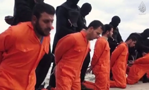 FILE- A screenshot of a video released by IS showing beheading of Egyptian Copts in the city of Sirte, Libya