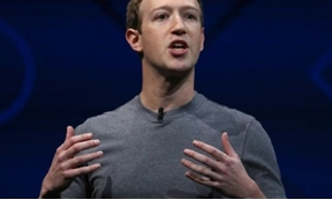 "Facebook CEO Mark Zuckerberg says he regrets his work was used ""to divide people rather than bring us together"" - AFP"