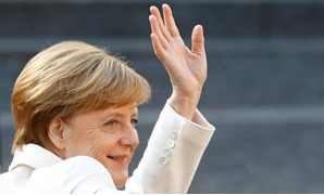 German Chancellor Angela Merkel waves during German Unification Day celebrations in Mainz, Germany, October 3, 2017. REUTERS
