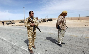 Libyan soldiers man a checkpoint in Wadi Bey, west of the Islamic State-held- Reuters