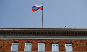 FILE- The Russian flag waves in the wind on the rooftop of the Consulate General of Russia in San Francisco, California, U.S., September 2, 2017. REUTERS