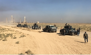 Members of Iraqi federal forces enter oil fields in Kirkuk, Iraq October 16, 2017. REUTERS/Stringer