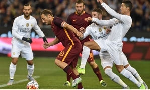 Cristiano Ronaldo tackles Francesco Totti, Reuters