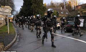 Members of the GIPN and RAID, French police special forces, walk in Corcy, northern France, as they carried out searches as part of an investigation into a deadly attack. AFP