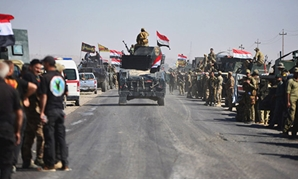 Members of Iraqi federal forces gather to continue to advance in military vehicles in Kirkuk. REUTERS