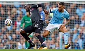 Crystal Palace's Christian Benteke in action with Manchester City's Nicolas Otamendi - REUTERS