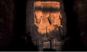 A stream of sunlight glazing the statuettes of Ramses, Ra and Amun in the central chamber; except for Ptah's statue, the goddess of darkness – Courtesy from YouTube