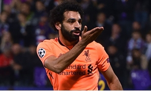 Mohamed Salah celebrating one of his goals, Liverpool official website