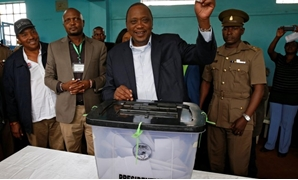 Kenya's President Uhuru Kenyatta casts his vote during a presidential election re-run in Gatundu - REUTERS