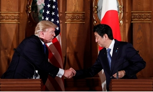 U.S. President Donald Trump and Japan's Prime Minister Shinzo Abe shake hands during a news conference at Akasaka Palace in Tokyo, Japan, November 6, 2017. REUTERS/Jonathan Ernst