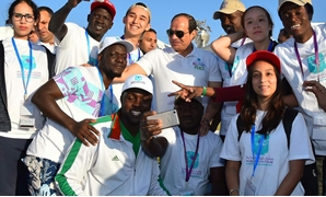 WYF's attendants posing for pictures while at Wednesday's marathon in presence of President Abdel Fatah Al Sisi - press photo