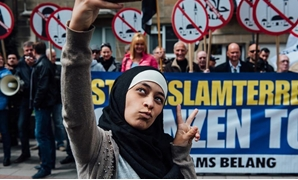 A young Muslim woman's audacious selfie in front of anti-Islamic protesters earned her global acclaim. Twitter