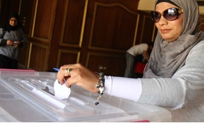 FILE – Egyptian Woman Casts Her Ballot In Election Box