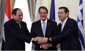 Egyptian President Abdel Fattah al-Sisi, Greek Prime Minister Alexis Tsipras, and Cypriot President Nicos Anastasiades shake hands during a meeting at the Presidential Palace in Nicosia, Cyprus November 21, 2017 - REUTERS/Yiannis Kourtoglou