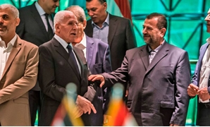 Heads of Fatah and Hamas delegations, Azzam al-Ahmad (L) and Saleh al-Aruri (R) after signing a reconciliation deal in Cairo, October 12, 2017. KHALED DESOUKI/AFP