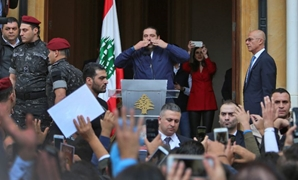 Lebanese Prime Minister Saad Hariri greets his supporters upon his arrival at his home in Beirut on November 22, 2017 after nearly three weeks of absence during which he announced his shock resignation from Saudi Arabia. AFP