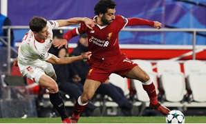 Soccer Football - Champions League - Sevilla vs Liverpool - Ramon Sanchez Pizjuan, Seville, Spain - November 21, 2017 Liverpool's Mohamed Salah in action with Sevilla's Clement Lenglet Action Images -