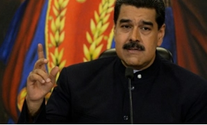 © AFP/File / by Esteban ROJAS | Venezuelan President Nicolas Maduro is demanding the opposing Democratic Union Roundtable (MUD) coalition work for the lifting of US sanctions