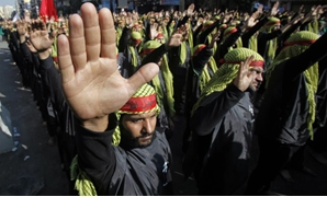 File- Lebanese Hezbollah supporters gesture as they march during a religious procession to mark Ashura in Beirut's suburbs November 14, 2013. REUTERS/Sharif Karim