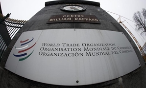 The World Trade Organization logo seen at the entrance of the headquarters in Geneva April 9, 2013. REUTERS/Ruben Sprich
