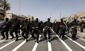 Mehdi Army fighters loyal to Shi'ite cleric Moqtada al-Sadr take part during a parade in Baghdad's Sadr city June 21, 2014.REUTERS/Ahmed Saad