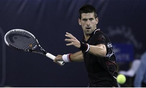 Novak Djokovic of Serbia hits a return to Cedrik-Marcel Stebe of Germany during their men's singles match at the Dubai Tennis Championships February 27, 2012. REUTERS/Mohammed Salem