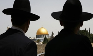 Ultra-Orthodox Jews look towards the Dome of the Rock in Jerusalem's Old City. (Photo credit: REUTERS)