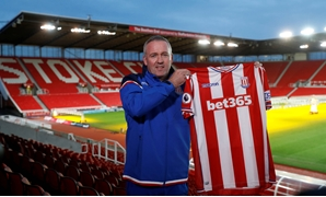 Soccer Football - Premier League - Stoke City - Paul Lambert Press Conference - bet365 Stadium, Stoke-on-Trent, Britain - January 16, 2018 New Stoke City manager Paul Lambert poses with a club shirt after the press conference Action Images via Reuters/Car