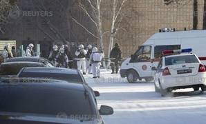 Law enforcement officers stand guard near a local school after a student with an axe attacked schoolchildren and a teacher in Ulan-Ude - REUTERS
