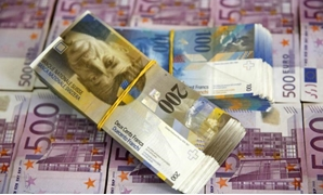 A picture illustration of Swiss Franc and Euro banknotes taken in central Bosnian town of Zenica - REUTERS