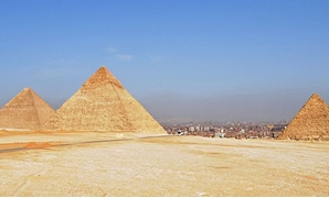 Pyramids of Giza, Egypt - Cairo skyline in the background March 2, 2010.- Wikimedia