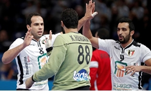 Men's Handball - Argentina v Egypt - 2017 Men's World Championship Main Round - Group D - AccorHotels Arena, Paris, France - 18/01/17 - Mohamed Ibrahim Ramadan, goalkeeper Karim Hendawy and Eslam Eissa of Egypt celebrate. REUTERS/Benoit Tessier