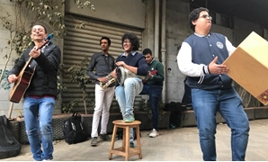 "The organizers of ""Mazzika Fel Share'a"" event playing music in street - Photo by Mira Maged."