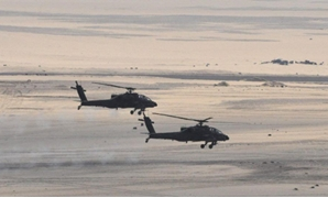 Egyptian Army's helicopters are seen during a launch of a major assault against militants, Egypt, in this undated handout picture made available by the Ministry of Defence February 9, 2018
