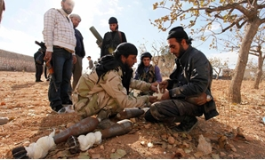 Free Syrian Army fighters preparing mortars to fire at forces loyal to President Bashar al-Assad. Credit Molhem Barakat-Reuters