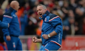 Stoke City manager Paul Lambert celebrates their second goal. REUTERS/Peter Powell
