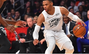 February 18, 2018; Los Angeles, CA, USA; Team LeBron guard Russell Westbrook of the Oklahoma City Thunder (0) controls the ball against Team Stephen center Joel Embiid of the Philadelphia 76ers (21) during the second half of the 2018 NBA All Star Game at