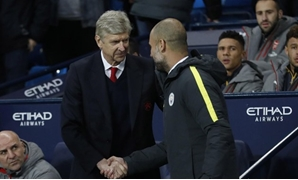 Britain Football Soccer - Manchester City v Arsenal - Premier League - Etihad Stadium - 18/12/16 Manchester City manager Pep Guardiola with Arsenal manager Arsene Wenger before the match Action - Reuters / Carl Recine