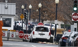 A passenger vehicle that struck a security barrier sits near the White House in Washington - Reuters