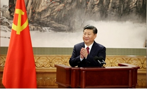FILE PHOTO: Chinese President Xi Jinping claps after his speech as China's new Politburo Standing Committee members meet with the press at the Great Hall of the People in Beijing, China October 25, 2017. REUTERS/Jason Lee/File Photo