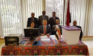 Egyptian Ambassador to Australia, Mohamed Khairat, with the embassy staff during the 2018 presidential election in Canberra - Egypt Today