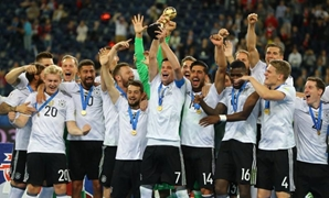 Soccer Football - Chile v Germany - FIFA Confederations Cup Russia 2017 - Final - Saint Petersburg Stadium, St. Petersburg, Russia - July 2, 2017 Germany's Julian Draxler celebrates with the trophy and teammates after winning the FIFA Confederations Cup R