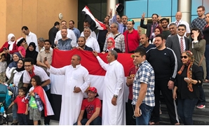 Egyptian community in Doha gathered outside a polling station after casting their vote on the second day of presidential election abroad - Egypt Today