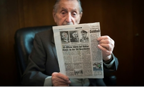 Marko Feingold, 104 years old, poses with a newspaper article at the Israeli Cultural Centre in Salzburg, Austria on March 15, 2018