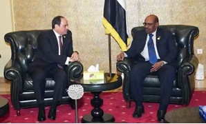 FILE - Egyptian President Abdel Fatah al-Sisi (L) meets with Sudanese counterpart Omar al-Bashir (R) in Addis Ababa on January 27, 2018- press photo