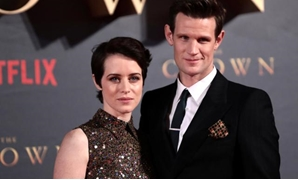 "FILE PHOTO: Actors Claire Foy, who plays Queen Elizabeth II, and Matt Smith who plays Philip Duke of Edinburgh, attend the premiere of ""The Crown"" Season 2 in London, Britain, November 21, 2017. REUTERS/Simon Dawson/File Photo"