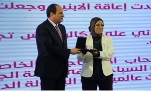 President Abdel Fatah Al Sisi honors one of the women that were honored at the Mother's Day ceremony on Wednesday - Press photo