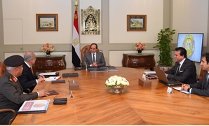 President Abdel Fatah al-Sisi (C), Prime Minister Sherif Ismail (L) Higher Education Minister Khaled Abdel Ghaffar (R) and head of Engineering Authority of the Armed Forces Kamel el Wazir (L) on March 22, 2018 - Press photo/Presidency