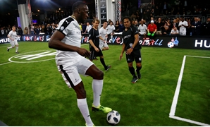 Soccer Football - Hublot Match of Friendship - Congress Center, Basel, Switzerland - March 21, 2018 Usain Bolt of Team Jose Mourinho in action with Christian Karembeu and Gaizka Mendieta of Team Diego Maradona REUTERS/Arnd Wiegmann